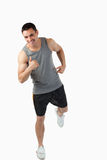 Young man warming up before workout Stock Image