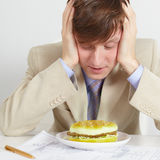 Young man was going to eat rotten meal Royalty Free Stock Image
