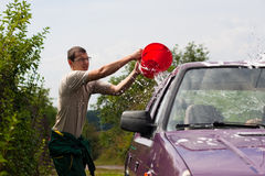 Young man wash car Stock Photo