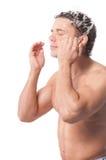 Young man wash face Stock Photos