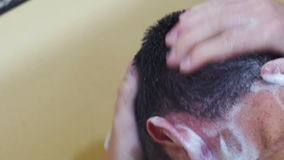 Young Man Washes his Head with Shampoo under the Shower stock footage