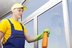 Young man washes window Stock Photos