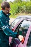Young man washing car Royalty Free Stock Photo