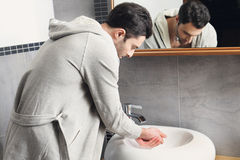Man washing his hands Royalty Free Stock Photos