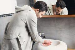 Man washing his hands Royalty Free Stock Photos
