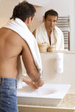 Young man washing his hands in sink Royalty Free Stock Images