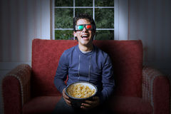 Young man watchin 3d Television Royalty Free Stock Image