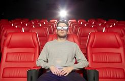 Young man watching movie in 3d theater Stock Images