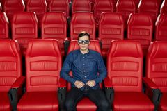 Young man watching movie in 3d theater Stock Image