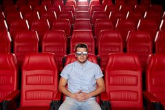 Young man watching movie in 3d theater Royalty Free Stock Images