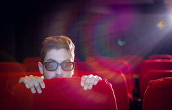 Young man watching a scary 3d film Royalty Free Stock Photography