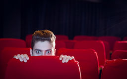 Young man watching a scary film Royalty Free Stock Photos