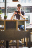 Young man watching tablet in cafe Royalty Free Stock Image