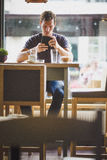 Young man watching tablet Stock Photography