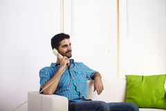 Young man watching television Royalty Free Stock Images