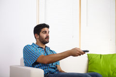 Young man watching television Royalty Free Stock Photo