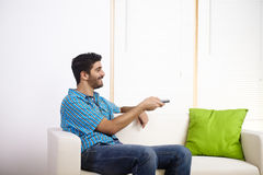 Young man watching television Royalty Free Stock Image