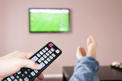 Young man watching the television, the remote cont. Men with the remote control, front of the television Stock Images