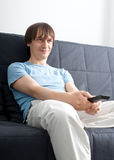 Young man watching tv stock photo