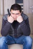 Young man  watching TV at home Royalty Free Stock Image