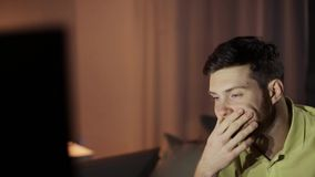 Young man watching tv at night stock footage