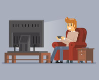 Young Man Watching TV Playing Game Sit Armchair Cartoon Character Flat Design Vector Illustration. Young Man Watching TV Playing Game Sit Armchair Character Stock Photo
