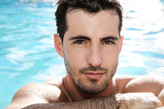 Young man in water stock images