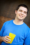 Young man with water cup Stock Photography