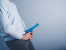 Young man with water pistol Stock Images