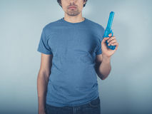 Young man with water pistol Stock Image