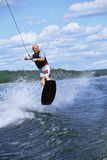 A young man water skiing Royalty Free Stock Photos