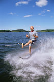 A young man water skiing royalty free stock photos