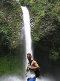 A young man and waterfall in the background Stock Image