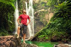 Young Man By The Waterfall Royalty Free Stock Photos
