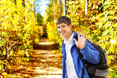 Young man wave goodbye Stock Images