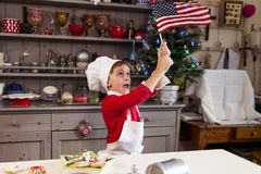 Young man waving the american flag Stock Photos