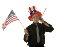 Young man wearing 4th of July hat and holding flag Stock Photos