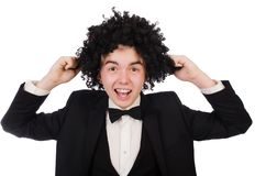Young man wearing afro wig. Funny man with curly hair style stock photo