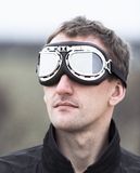 Young man wearing aviator goggles Royalty Free Stock Photos