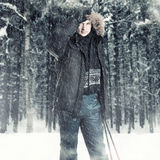 Young man wearing black fur hood winter jacket Royalty Free Stock Image
