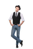 Young man wearing black hat jacket and tie. Full length. Royalty Free Stock Images
