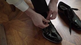 Young man wearing black shoes stock video