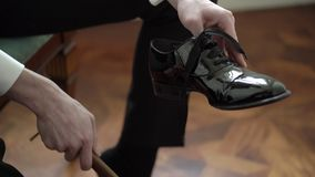 Young man wearing black shoes stock video footage