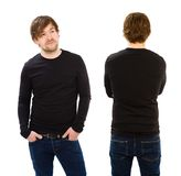 Young man wearing blank black long sleeve. Photo of a man wearing blank black long sleeve shirt, front and back. Ready for your design or artwork Stock Images