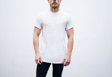 Young man wearing blank tshirt and blue jeans on Stock Photos