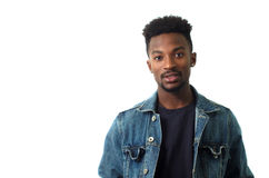 Young man wearing blue jeans jacket on white background Stock Photography