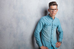 Young man wearing a blue shirt and glasses Royalty Free Stock Images