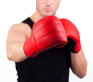Young man wearing boxing gloves Stock Image