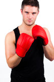 Young man wearing boxing gloves Royalty Free Stock Image