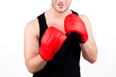 Young man wearing boxing gloves Stock Photography